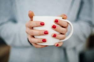 hands holding coffee mug