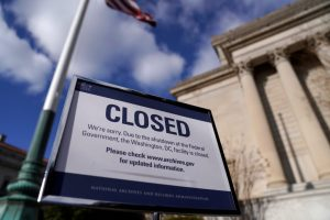 A sign declares the National Archive is closed due to a partial federal government shutdown in Washington
