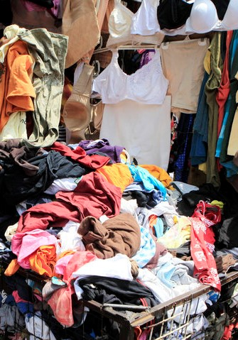 A vendor sells secondhand cloths at a stall in the busy Gikomba market in Nairobi