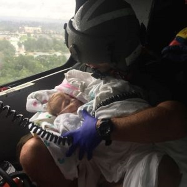 Coast Guard aircrew assists infant during the aftermath of Hurricane Harvey