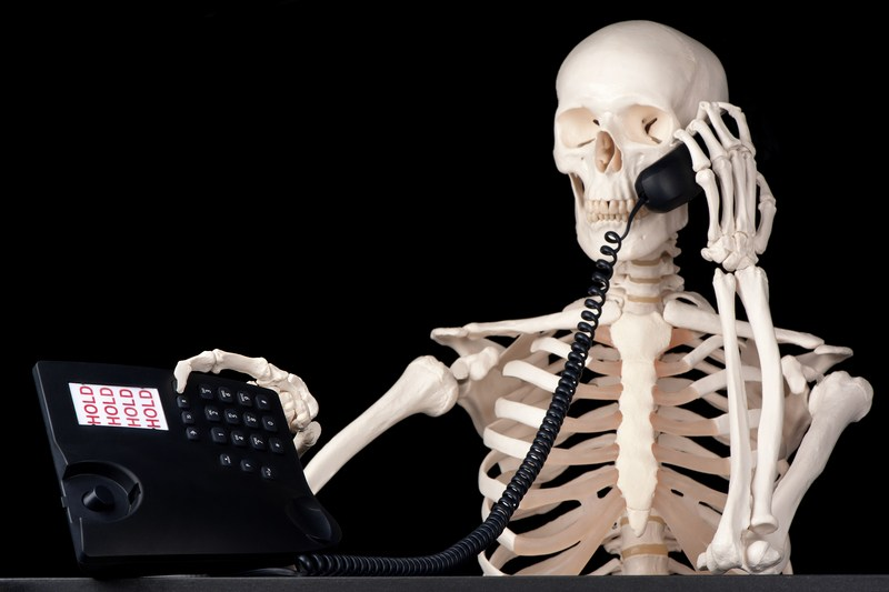 skeleton-on-phone-dreamstime_s_32055584