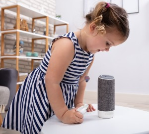Girl Looking At Wireless Speaker