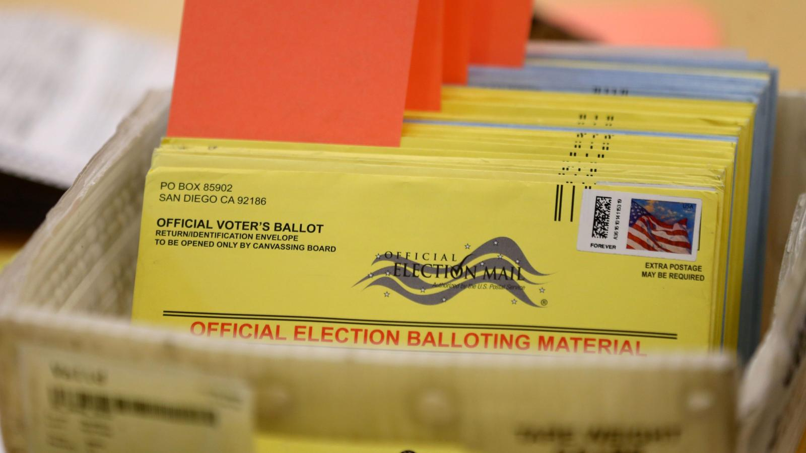 mail-in ballot with stamps