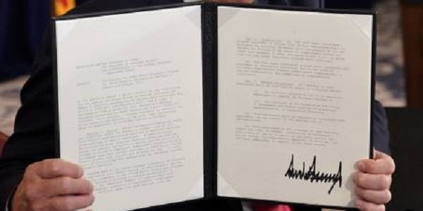 Exec order holding cropped
